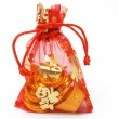 Chinese new year gold ingots and coins in red decorative sachet — Stock Photo