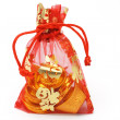 Chinese new year gold ingots and coins in red decorative sachet — Stock Photo #6144260