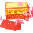 Chinese new year gift box, red packets and ornaments — Stock Photo