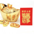 Chinese new year gold ingots and red packet — Stock Photo