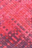 Red woven palm leaves mat — Stock Photo