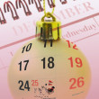 Royalty-Free Stock Photo: Christmas bauble and calendar