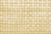 Woven palm leaves mat background — Stock Photo