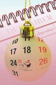 Christmas bauble and calendar — Stock Photo