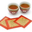 Stock Photo: Chinese longevity tecups and red packets