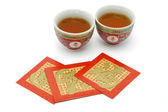 Chinese longevity tea cups and red packets — Stock Photo
