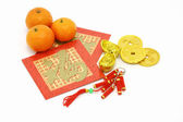 Chinese New Year ornaments, oranges and red packets — Stock Photo