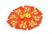 Chinese red packets and ornaments — Stock Photo
