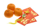 Chinese New Year ornament, oranges and red packets — Stock Photo