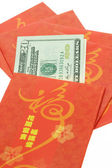 Chinese New year red packets and US dollars — Stock Photo