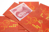 Chinese New Year red packets and Renminbi currency — Стоковое фото