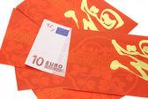 中国の旧正月パケットとユーロ通貨ノート — ストック写真