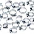 Metal hose clamps of different sizes - Stock Photo