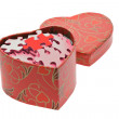 Red and pink jigsaw puzzles in heart shape gift box — Stock Photo