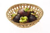 Mangosteens in basket — Stock Photo