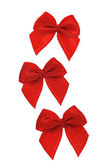 Three red decorative bows — Stockfoto