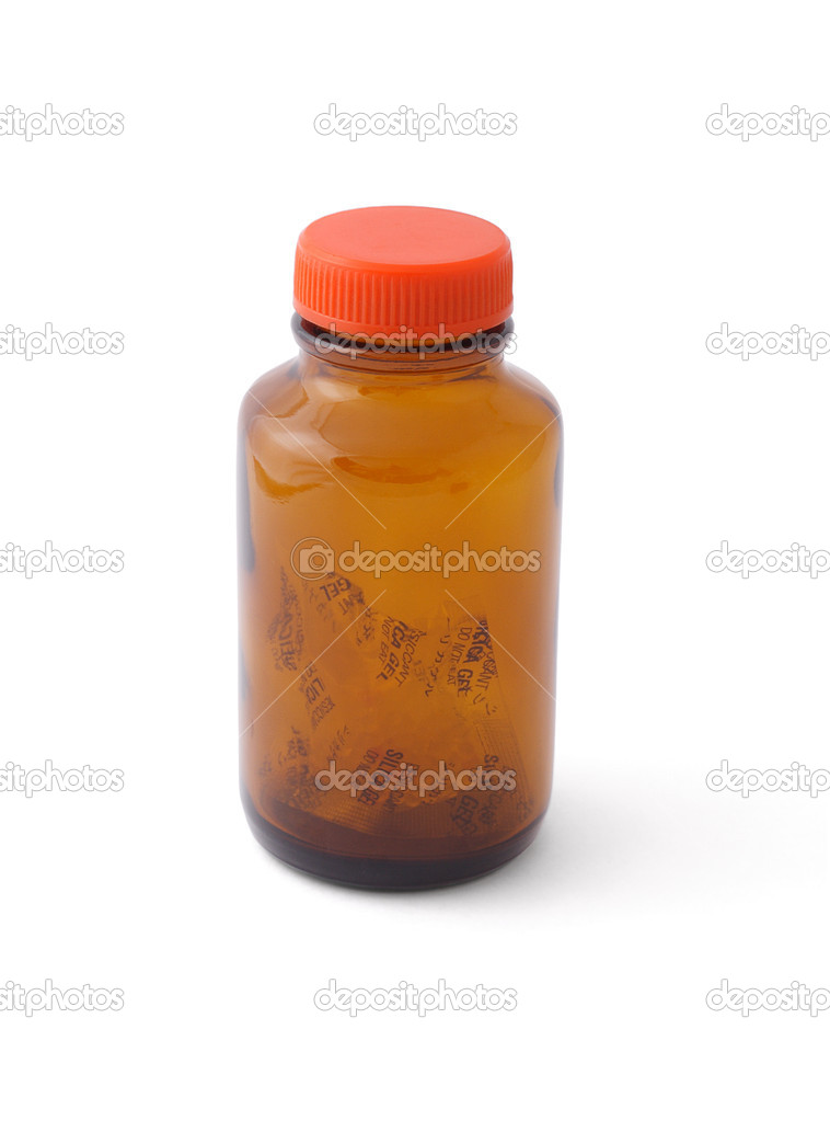 Empty glass bottle left with silica gel inside  Stock Photo #6542549