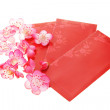 Plum blossoms and red packets — Stock Photo