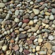 Small round pebble stones background — Stock Photo #6256783