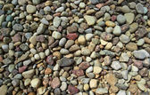 Small round pebble stones background — Stock Photo