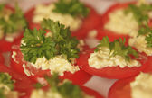 Tomatoes slices with cheese, mayonnaise and parsley — Stock Photo