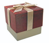 Closed gift box with a gold ribbon — Stock Photo