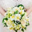 Bride holding beautiful wedding flowers bouquet — Stock Photo #6071514
