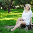 Young pregnant woman in park — 图库照片