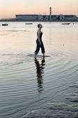 Bald Woman Walking Through Water — Stock Photo