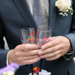 Groom is holding painting glasses — Stock Photo