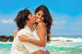 Attractive couple on the beach — Stock Photo