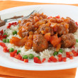 Meatballs with rice and peas — Stock Photo