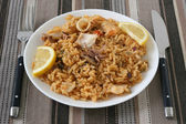 Rice with squid and fish — Stock Photo
