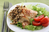 Fried chicken with mushrooms — Stock Photo
