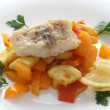 Codfish with vegetables — Stock Photo