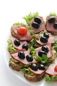 Canape with ham — Stock Photo