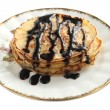 Pancakes with chocolate sauce — Stock Photo