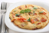 Omelet with ham and tomato — Stock Photo
