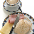 Bread with cheese, ham and coffee — Stock Photo