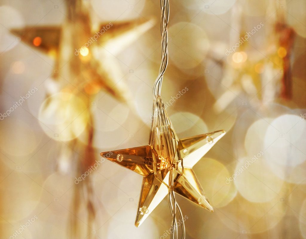 Golden Christmas stars with very shallow focus — Stock Photo #6085452