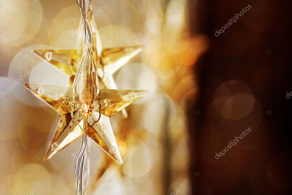 Golden Christmas stars with very shallow focus — Stock Photo #6085455