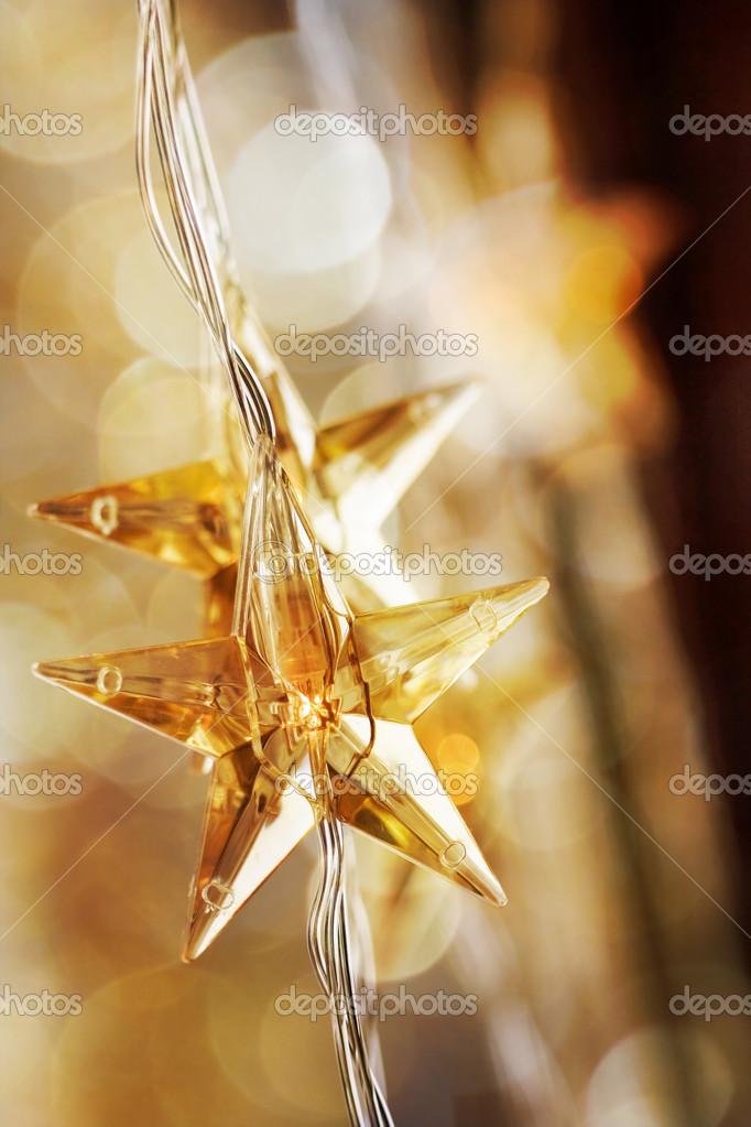 Golden Christmas stars with very shallow focus — Stock Photo #6085457