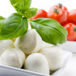 Mozzarella, tomatoes and basil — Stock Photo #6109555