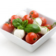 Mozzarella, tomatoes and basil — Stock Photo