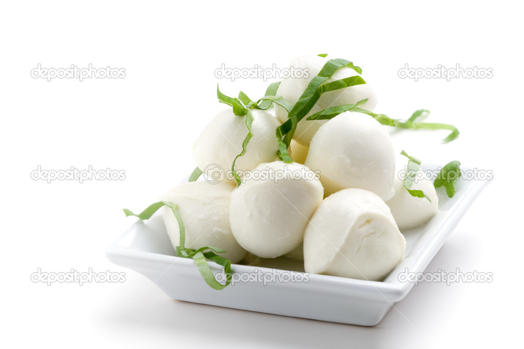 Mozzarella, tomatoes and fresh basil leaves on white background — Stock Photo #6109566