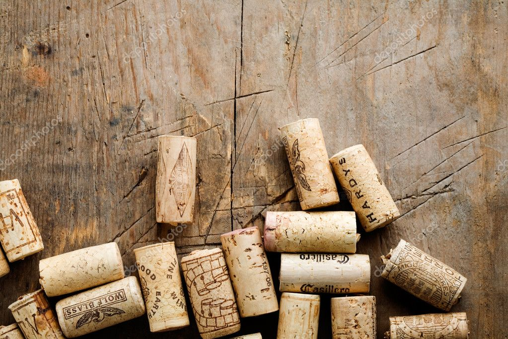 Bunch of wine corks on wooden table — Stock Photo #6109736