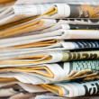 Stock Photo: Pile of newspapers