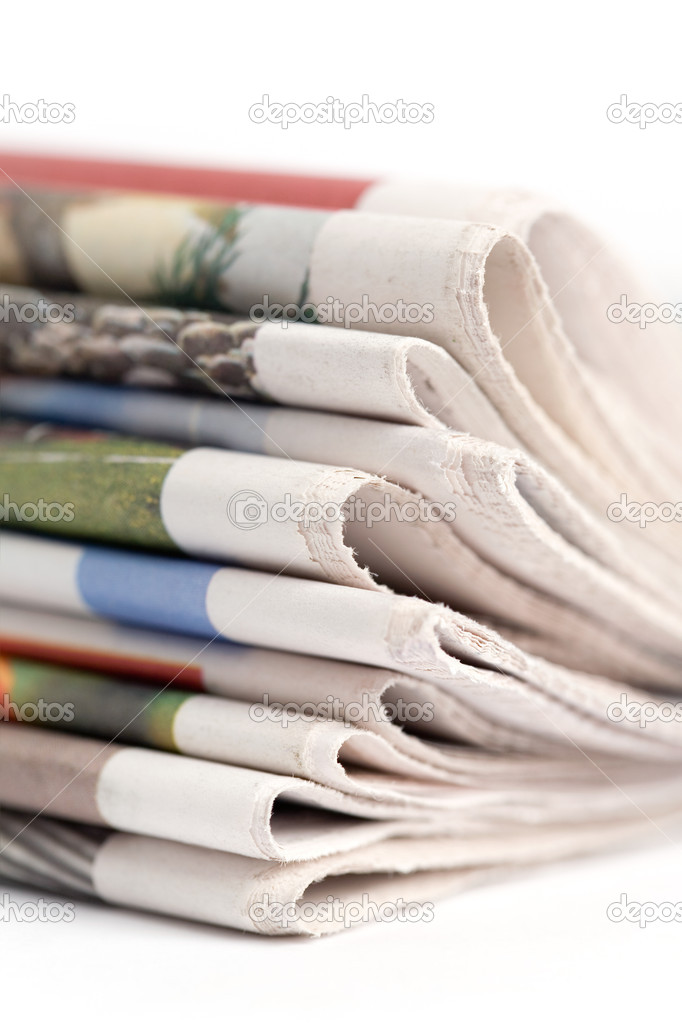 Stack of newspapers on white background — Stock Photo #6286617