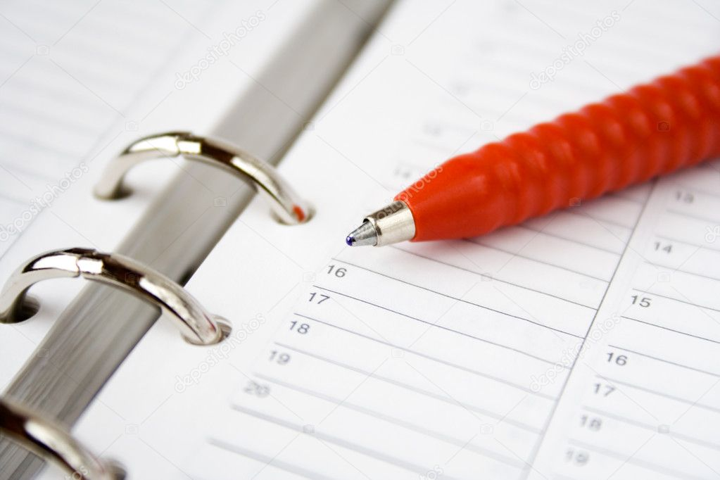 Red pen on top of blank calendar pages  Stock Photo #6286717