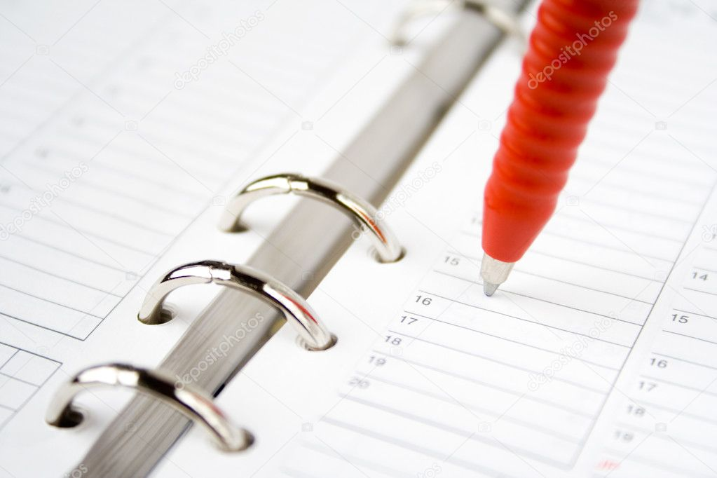 Red pen on top of blank calendar pages — Stock Photo #6286727